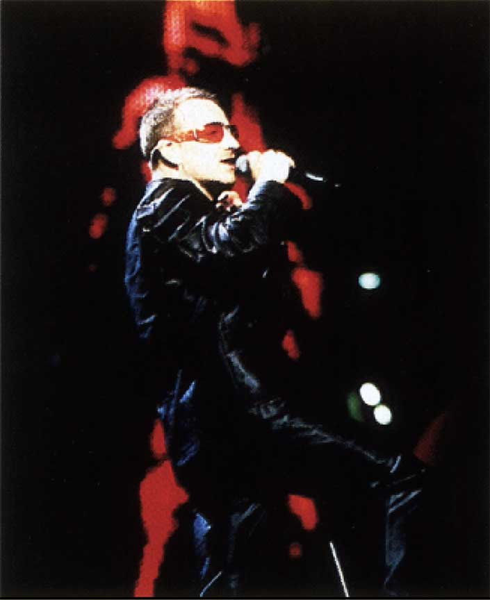 Bono in hand perforated Custom Made leather Suit by Carla Dawn Behrle